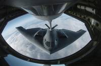 A B2 Spirit bomber refuels from a KC135 Stratotank