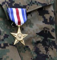 Close-up of a medal on the uniform of a soldier