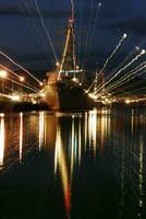 Holiday lights shine from guidedmissile destroyer