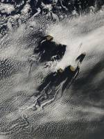 Shipwaveshaped wave clouds and cloud vortices indu