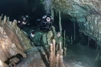 Technical divers in Dreamgate cave system in Mexic