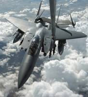 An F15 E Strike Eagle receives fuel from a KC10 Ex