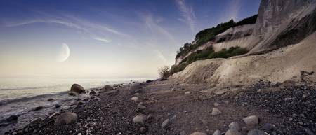 Tranquil seaside and Mons Klint cliffs against ris