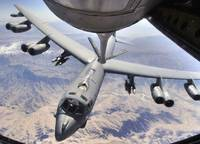 A B52 Stratofortress receives fuel from a KC135 St