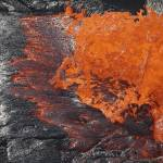 """Lava bursting at edge of active lava lake, Erta Al"" by stocktrekimages"