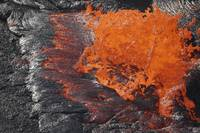 Lava bursting at edge of active lava lake, Erta Al