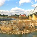 """Bridge Over Llano River Panorama"" by MarksClickArt"