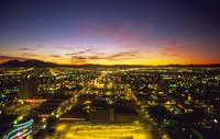 Nevada, Las Vegas, View Of Sunrise Over Lit-Up Cit