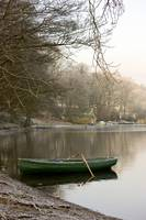 Rowboat Sitting At The Shore Of A Lake, Cumbria, E