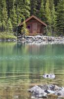 Wooden Cabin Along A Lake Shore