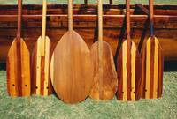 Hawaii, Different Shaped Canoe Paddles In Front Of