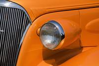 Orange Painted Vintage Car's Headlight And Front