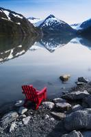 Red Adirondack chair at Portage Lake with Chugach