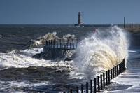 Waves Crashing By Lighthouse At Sunderland, Tyne A