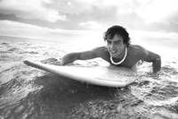 Hawaii, Oahu, Young Man Paddling On His Surfboard