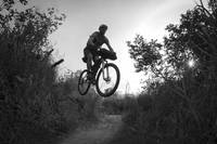 Man Mountain Biking And Making Jumps, Anchorage Hi