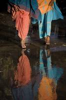 Reflections In Water Of Women Walking, Jodhpur, In