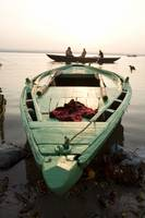 Green Stationary Boat At Water's Edge, Ganges Riv