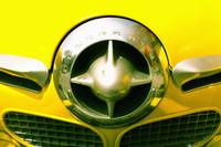 The Grill Of A Yellow Studebaker Car