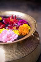 Flowers Floating In A Bowl Filled With Water Bhak