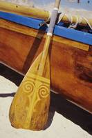Close-Up Detail Of Wooden Paddle And Outrigger Can