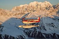 View of a Cessna 185 floatplane in Alaska Range ov