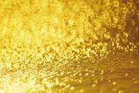 Closeup Of Golden Shimmering Reflections Off Water