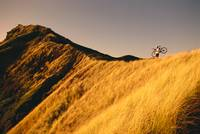 Mountain Biker On Ridge With Bike On Shoulder, Gol