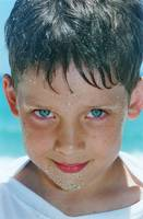 Close Up Of Boy Covered In Sand