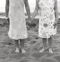 Girls Holding Hand On Beach