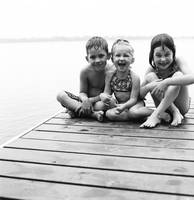 Kids Sitting On Dock