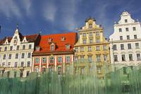 Colourful Buildings And Fountain On Rynek Square