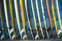 Row Of Surfboards Lined Up Against A Wall