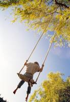 Low Angle Shot, Boy On Swing