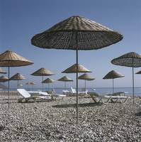Palapas And Sun Loungers On Beach, Turkey