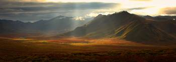 Panoramic Image Of The Cloudy Range With Shafts Of