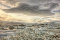 Lenticular Clouds Over The Ice Lagoon Of Jokulsarl