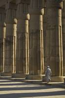 Temple Guard Walking Past Columns In Court Of Amen