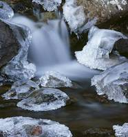 Blurred Motion of Creek Surrounded by Ice SC Alask