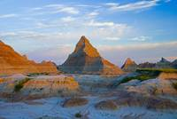 A Red Sunrise Illuminates The Hills In Badlands Na