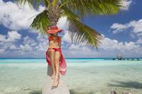 French Polynesia, Tahiti, Woman Relaxing On Palm T