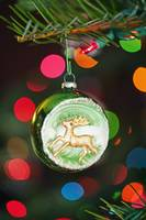 An Ornament With A Reindeer Hanging From A Christm