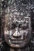 A face sculpture on a stone wall at angkor wat, Ca