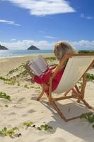 Hawaii, Oahu, Lanikai Beach, Woman reading a book