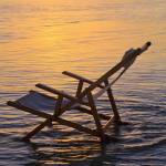 """Hawaii, Lanikai, Empty Beach Chair At Sunset"" by DesignPics"