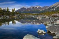 Bonanza Ridge and its reflection on a waterhole by