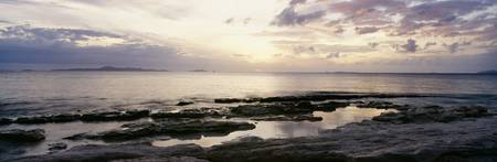Fiji, Sunrise Over Ocean And Rocky Coastline