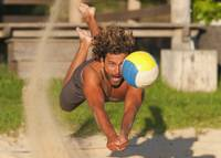 A Man Diving For A Beach Ball, Tarifa, Cadiz, Anda