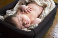 sleeping baby in a basket