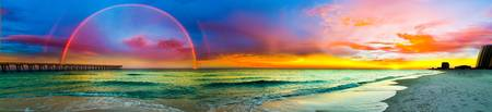 Wide Panorama of Double Rainbow Sunset over Beach